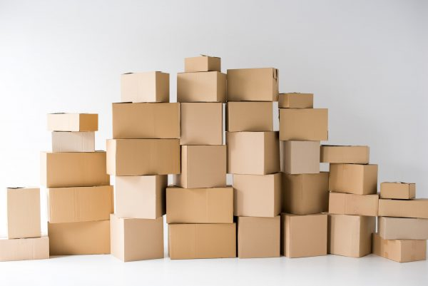 brown cardboard boxes stacked on each other on white